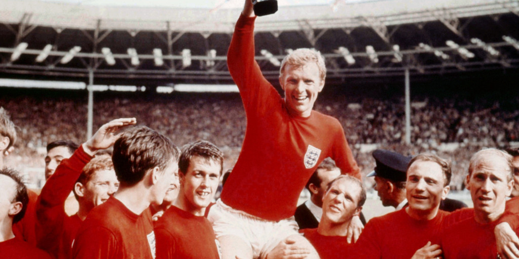 England's soccer captain Bobby Moore, carried shoulder high by his team mates holds aloft the FIFA World Cup in this July 30 1966 file photo. England defeated Germany 4-2 in the final of the 1966 tournament played at London's Wembley Stadium. (AP Photo)